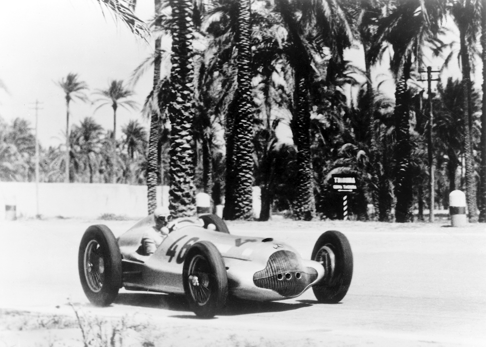 Triple victory in the Tripoli Grand Prix, May 15, 1938: Hermann Lang (photo) ahead of Manfred von Brauchitsch and Rudolf Caracciola, all driving Mercedes-Benz W 154 cars.
